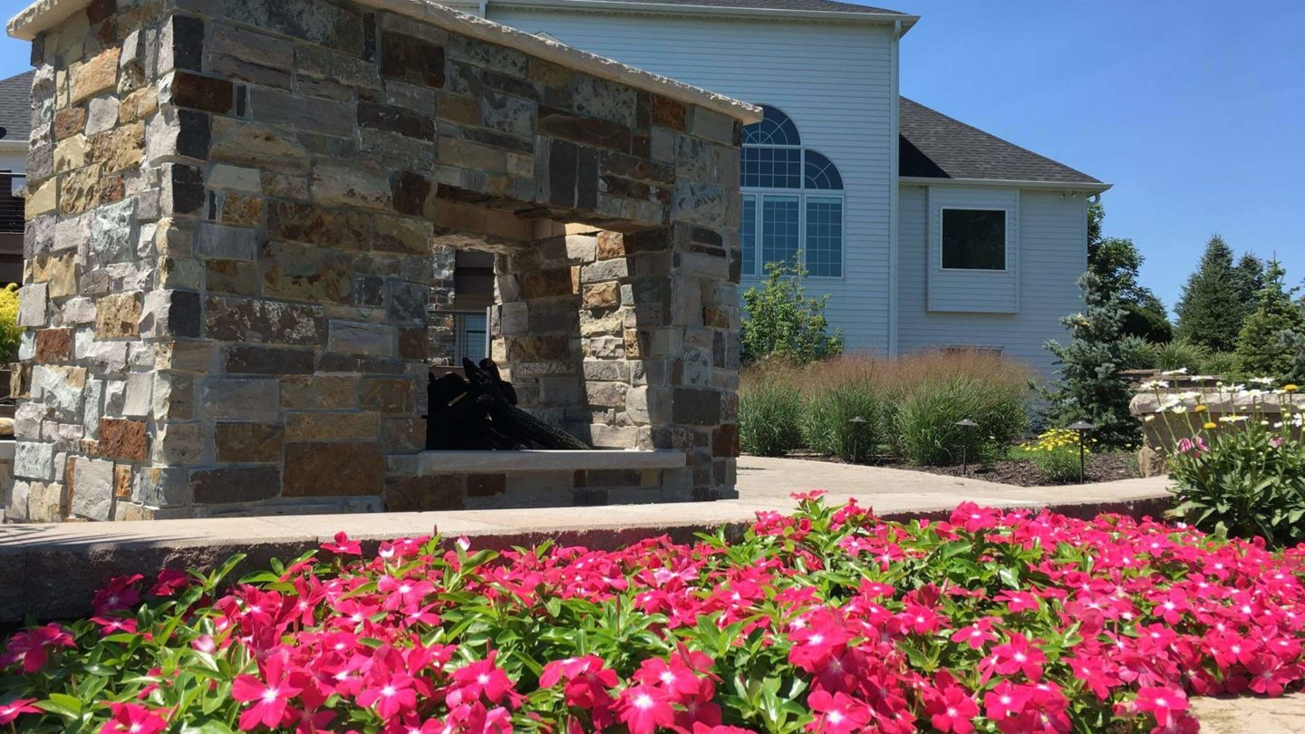 Flower softscape and outdoor fireplace