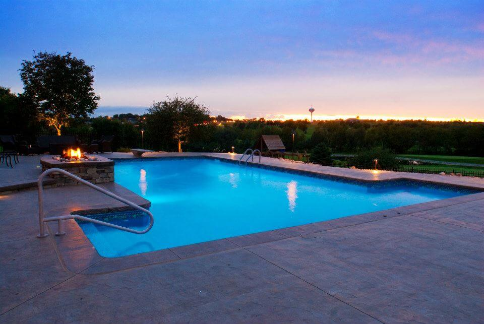 Pool fire feature and landscape lighting