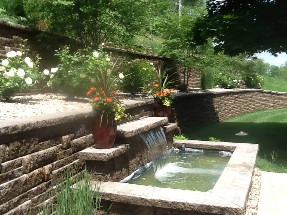 Waterfall retaining wall with pond